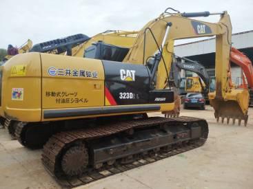 北京52万元出售卡特彼勒中挖323挖掘机